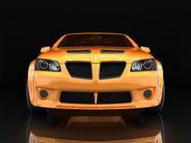 Sports car front view. The image of a sports gold car on a black background. Royalty Free Stock Images