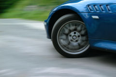Sports car front wheel spinning and turning Stock Photos