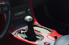 Sports car gear shift on a red console Royalty Free Stock Photo