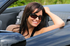Sports Car Girl. Beautiful Brunette Young Woman Sat In A Convertible Sports Car Royalty Free Stock Images