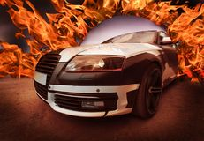 Sports car goes from Ring of Fire. Concept. Close-up Stock Images