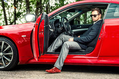 Sports car. Handsome young man in his new sports car Royalty Free Stock Photography
