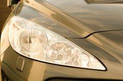 Sports car headlight gold Royalty Free Stock Image