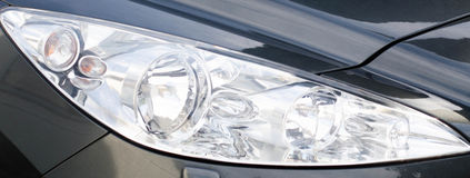 Sports car headlight grey Stock Photography