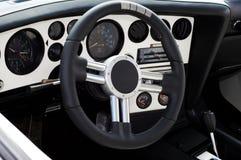 Sports car interior. (metallic and black stock image