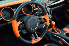 Sports car interior with orange accents. Stock Image