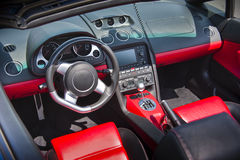 Sports car interior in swede leather. Modern Italian sports car interior in red leather Stock Photos