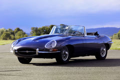 A sports car Jaguar E-Type S3 V12 engine, black. Shot on airport Royalty Free Stock Photo