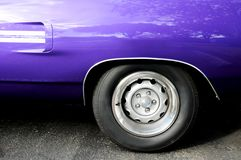 Sports car (left rear). Side view of a purple sports car in a South Florida parking lot Stock Photography