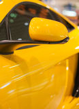 Sports car model. Part of yellow sports car model Stock Photography