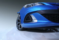 Sports car. Modern blue sports car in showroom Stock Photography