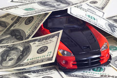 Sports car and money Stock Photos