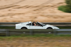 Sports car in motion Stock Photo