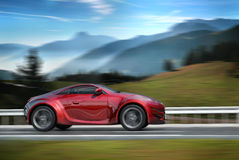 Sports car moving on the road Royalty Free Stock Images