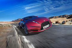 Sports car moving on the road Stock Photography