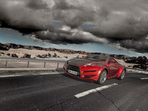 Sports car moving on the road. stock images