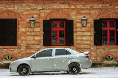 Sports car near the old building in winter Royalty Free Stock Images