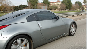 Free Sports Car On The Freeway Royalty Free Stock Image - 325576