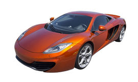 Sports car in orange, isolated Royalty Free Stock Photos