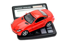 Sports car placed on a calculator Stock Images