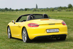 A sports car Porche BOXTER S, YELLOW. Shot on airport Hertelendy, 26 June 2012, Hungary. Stock Photography