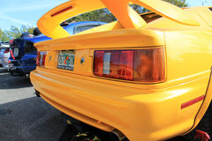 Sports car rear in lineup. Yellow sports car rear closeup. Lotus Esprit outdoors  on a sunny day. natural daylight Stock Photo