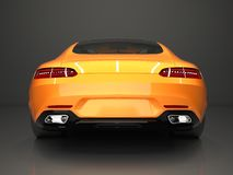 Sports car rear view. The image of a sports gold Stock Photos