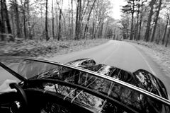 Sports Car on Road. Black Sports Car driving down road royalty free stock photo