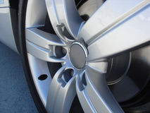 Sports Car's Wheel 2. Sports car with no brand and no sign, in perfect shape, brand new, the day it was delivered Stock Photos