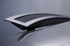 Sports car spoiler. Rear automatic spoiler of a modern sports car Stock Images