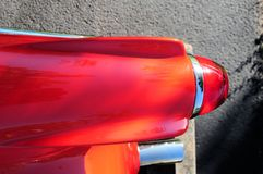Sports car tail light & tail pipe. Rear view of a red sports car in a South Florida parking lot Royalty Free Stock Image
