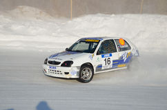 Sports car turns into a skid on the icy track royalty free stock photo
