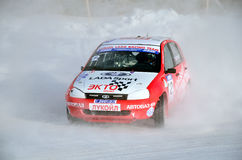 Sports car turns into a skid on the icy track stock photography