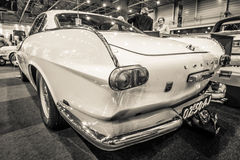 Sports car Volvo P1800, 1964. MAASTRICHT, NETHERLANDS - JANUARY 14, 2016: Sports car Volvo P1800, 1964. Sepia. Rear view. International Exhibition InterClassics royalty free stock photo
