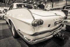 Sports car Volvo P1800, 1964. MAASTRICHT, NETHERLANDS - JANUARY 14, 2016: Sports car Volvo P1800, 1964. Sepia. Rear view. International Exhibition InterClassics Royalty Free Stock Photo