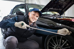 Sports car in a workshop. Sports car in a service workshop - fixing a dent Stock Photo