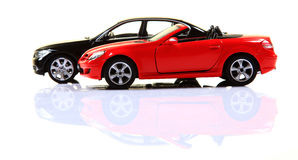 Sports cars. Mercedes slk350 and bmw 3series cars isolated on white background Stock Photo
