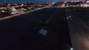 Sports cars drive drifting on empty plain road in night city follow fpv shot