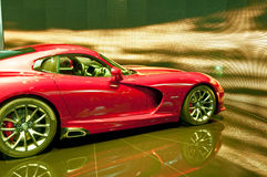 Sports cars -Red Dodge Viper SRT 2013. New 2013 model of Dodge Viper SRT on display at the auto show royalty free stock images