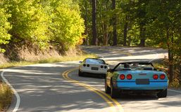 Sports cars on a winding road Stock Image