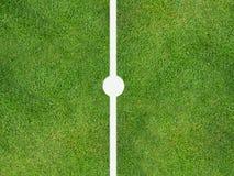 Sports centre spot. Sports pitch centre spot on grass Stock Photo