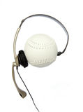 Sports Chat. Headset over a softball symbolizing sports chat royalty free stock image