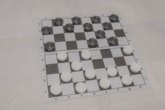 Checkers game. Sports checkers, take first place, be developed stock photo