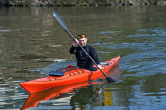 Sports cheerful man in red kayak Stock Images