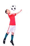 Sports Children. Boy playing with football against white background Stock Photos