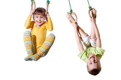 Sports children on gymnastic rings Royalty Free Stock Photography