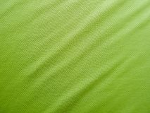 Sports clothing fabric jersey texture. Green sports clothing fabric jersey texture Royalty Free Stock Photo