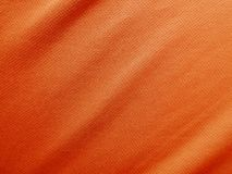 Sports clothing fabric jersey texture. Orange sports clothing fabric jersey texture Stock Images