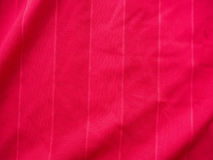 Sports clothing fabric jersey texture. Red sports clothing fabric jersey texture Royalty Free Stock Photo