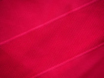 Sports clothing fabric jersey texture. Red sports clothing fabric jersey texture Stock Photos